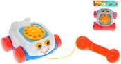 Baby telefon tahací dětský 19cm se šňůrkou na kolečkách obličej plast